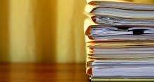 Stack of papers in file folders