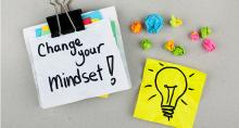 "Notepad with phrase ""Change Your Mindset"" written on it"
