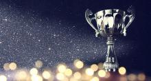 Trophy on glittering background