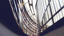 Image of library shelves along wall of windows
