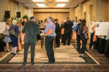 Attendees mingle in the lobby prior to the Thursday night welcome reception