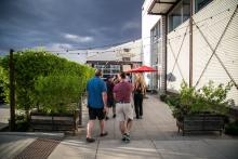 Attendees walk into Culinary Dropout in Tempe for fun and games