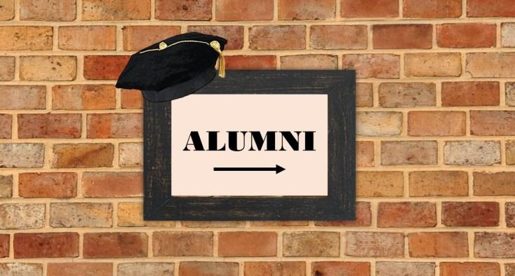 brick wall with a sign that states Alumni